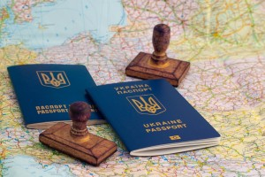 Two Ukrainian passports, stamps of border crossing  and map of Europe